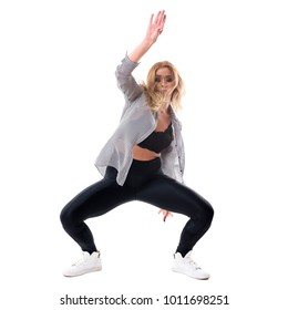 Funky blonde woman dancing dancehall bending backwards with flowing clothes and hair. Full body length portrait isolated on white studio background.