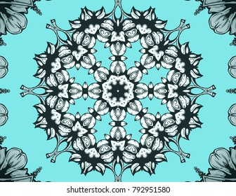 Funky Kaleidoscope with a floral feel in black, silver and blue.