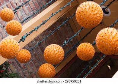 Funky Orange Sphere shaped outdoor hanging light fixtures