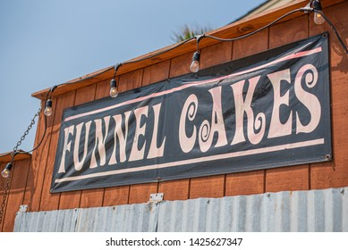 Funnel Cakes sign at the beach carnival