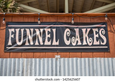 Funnel Cakes sign on the beach boardwalk