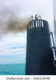 FUNNEL SHIP SMOKESTACK ENGINE EXHAUST TO AIR ON SEA JOURNEY , SKY CLOUD OVER WATER BACKGROUND