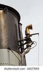 Funnel and whistle from a steamship against a grey sky