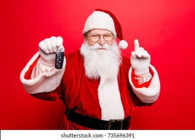 Funny aged grandfather in red traditional outfit and headwear. X mas noel surprise time! Success, happiness, dream, december, buyer, ownership, property, purchase, rent, sell, cars concept