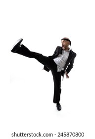 funny aggressive businessman wearing suit in kung fu kick or karate attack isolated on white background in business strength and competition concept