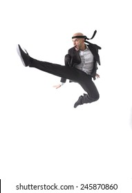 funny aggressive businessman wearing suit jumping on the air in kung fu kick or karate flying attack isolated on white background in business strength and competition concept
