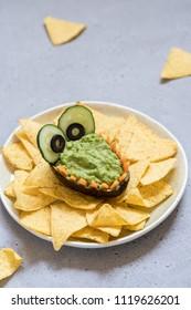 Funny alligator avocado bowl guacamole dip and nachos