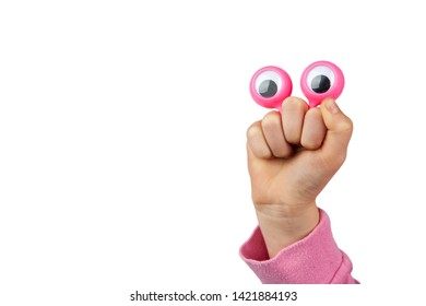 Funny amused character depiced with googly eyes and childs hand isolated on white background with copy space