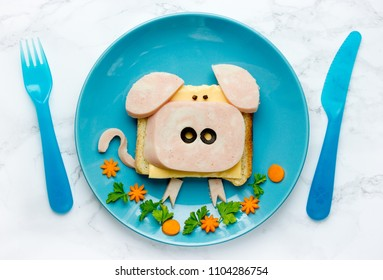Funny animal sandwich for kids shaped cute pig with cheese and ham, food art idea