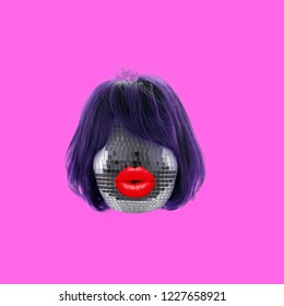 Funny art collage. Concept disco ball with hair and lips.
