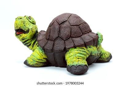 funny artificial turtle garden concrete figure for backyard design decoration or park landscaping, stone animal object cheerful isolated on white background, nobody.