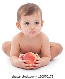 Funny baby with a big apple in her hands. Isolated on white background.