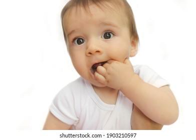 Funny baby boy on a light background.