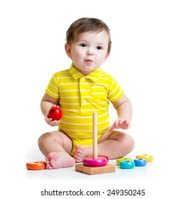 funny baby boy playing with colorful toy pyramid isolated