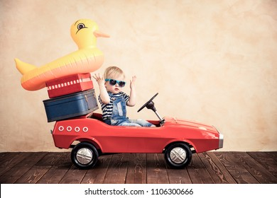 Funny baby boy playing at home. Summer vacation and travel concept