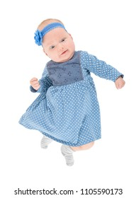 funny baby girl dressed in blue dress