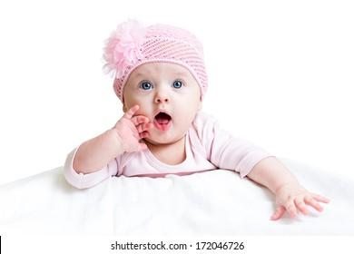 funny baby girl lying on white