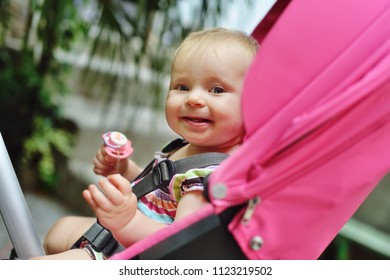 funny baby girl  sitting in the stroller