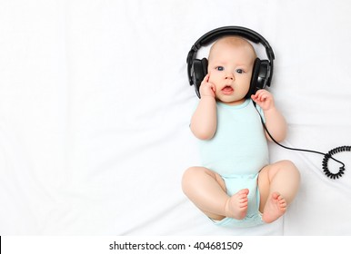 funny baby little boy in headphones