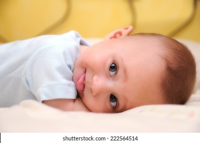 funny baby making fun lying in bed