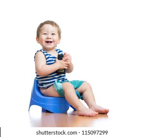 funny baby sitting on chamber pot
