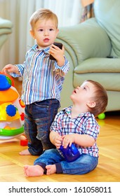 funny baby toddlers playing toys at home