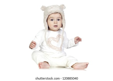 Funny Baby with a Winter Hat Isolated on White