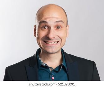 funny bald dude expressive portrait. Studio shot