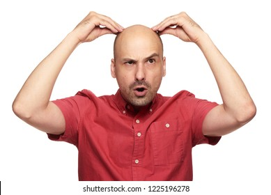 Funny bald guy shocked. man hair loss concept. Isolated on white studio background
