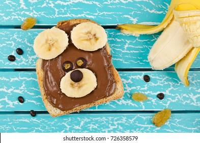 Funny bear face sandwich for kids snack food. Creative breakfast idea for kids