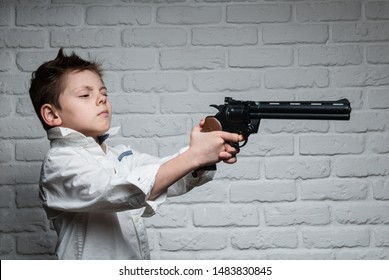 funny beautiful little kid holding big gun and aiming