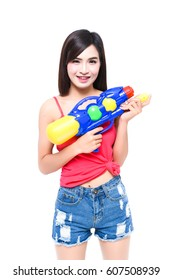 Funny beautiful woman shoot water gun on white isolate background on Songkran festival of Thailand