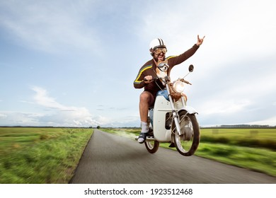 Funny biker doing a wheelie with his moped