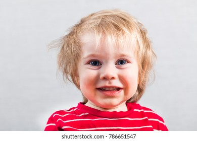 Funny blonde boy 3 year big eyes red clothing