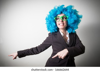 funny blue wig beautiful young businesswoman on gray background