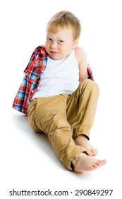Funny blue-eyed three-year boy on a white background. Studio photo