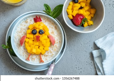 Funny bowls with oat porridge with bunny, chick and flower for Easter