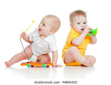 Funny boy baby  with musical toys. Isolated on white background