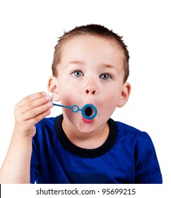 funny boy blowing bubbles isolated