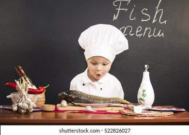 funny boy chef prepares fish