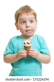 Funny boy eating ice cream isolated on white