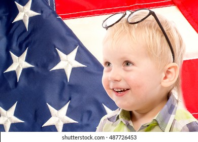Funny boy with glasses, close up portrait, on US flag background