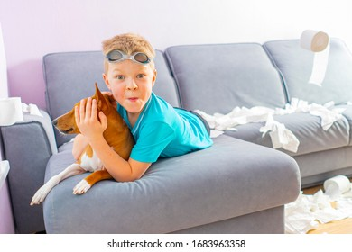 funny boy at home during quarantine COVID19 on the couch plays