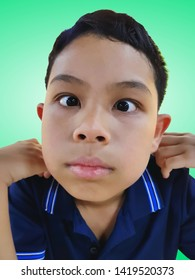 Funny Boy Making Silly Face Isolated on Green Background