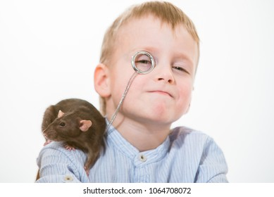 Funny boy with a monocle and a rat on his shoulder