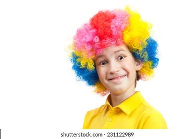 funny boy in multi-coloured wig