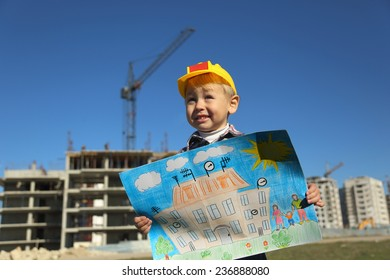 funny boy with a picture of the future house