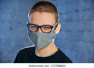 Funny boy teenager in a protective mask on his face from a virus