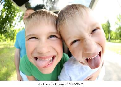 Funny boys looking into camera