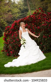 funny bride is laughing and playing with her arms while holding the bouquet